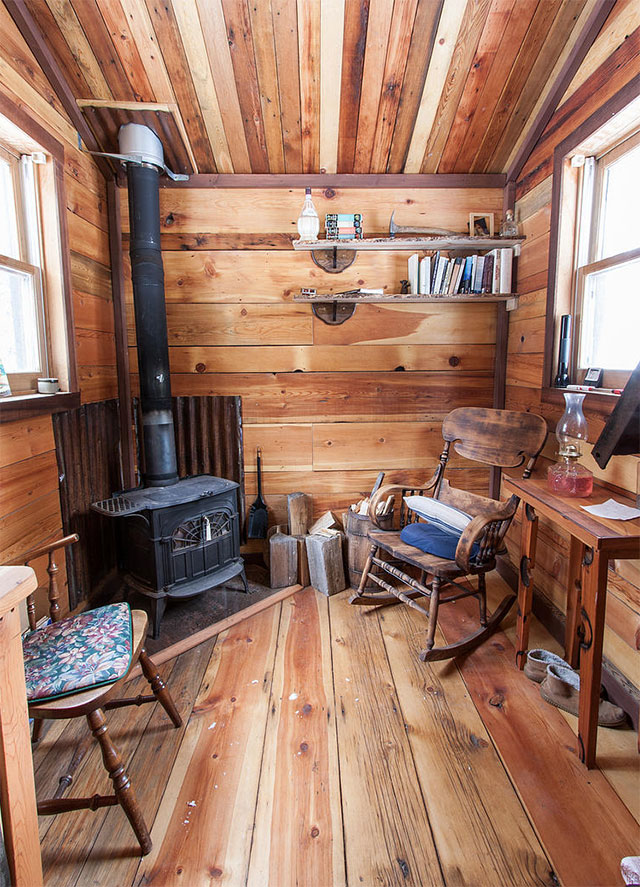 The main living area has a wood burning stove, a small kitchen area with  counter space and a propane cooking stove, seating areas, and several  storage ... - 96 Sq Ft Potomac Micro Cabin